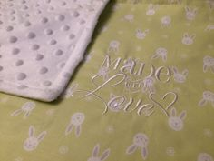 Embroidered baby blanket, embroidered baby fleece, car seat blanket, crib blanket, Moses Basket blanket, Pram blanket, NICU incubator cover, Made with Love. Free personalisation with this listing. A beautiful, embroidered handmade baby blanket in a pale lime, with a white & grey bunny design. Embroidered with the words, 'Made with Love'. The front of the blanket is a cotton fabric and the back is a white dimple fleece. Would make a fabulous baby shower or newborn gift. Shipping from...