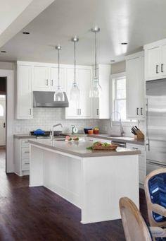 Kitchen-dark wood floors, white cabinets, white tile backsplash