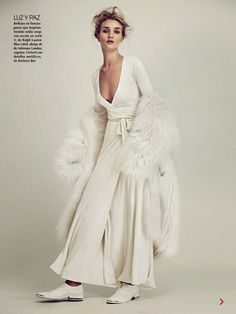 Awe-inspiring spread featuring Rosie Huntington-Whiteley in all-white and fur // Photo by James Macari for Vogue Mexico