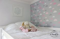 A DIY stenciled accent wall in a girl's bedroom using the Cloud Allover Stencil pattern from Cutting Edge Stencils. http://www.cuttingedgestencils.com/clouds-allover-stencil-pattern-for-walls.html