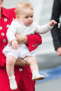 Baby Prince George in Kate's arms. Oh Cute Prince George he is so happy with his mother arms.