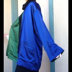 """Isaac Mizrahi Silk Reversible Designer Cover Up Great professional work shrug, shawl, wrap. Excellent condition. No snags or rips. Smoke free home. Made in Hong Kong. 100% Silk. Women's Size """"P"""". Wear a green or wear a blue. This has pockets. Glamorous. Sheen. Luster. Lustrous. Luxurious. Fancy. Formal. Party. Eveningwear. Sleek and sexy. Goddess. Priestess. Church. Power blue. Bussiness attirer. Cocktail happy hour. Wedding. Classy event. Flowy. Bold. Colorful. Shine. Power blue. Mystic…"""