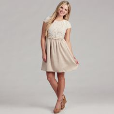 @Overstock - Incredibly stylish, this cap-sleeve dress from Gabby Skye features a lovely lace embellishment. A scoop neck and empire waist finishes this fully lined dress.   http://www.overstock.com/Clothing-Shoes/Gabby-Skye-Womens-Ivory-Champ-Lace-Dress/6523176/product.html?CID=214117 $66.99
