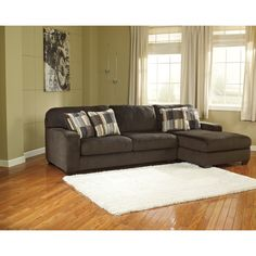 Enhance your livingroom with the Western sectional sofa from Signature Design. With its natural chocolate color and soft polyester upholstery this sectional makes it easy to sit back and relax.