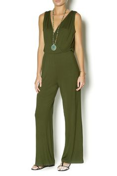 Effortlessly stylish and endlessly comfortable, a soft jersey jumpsuit in a rich olive green that features a surplice bodice and slouchy open twist draped back with thin elastic waistline. Throw on this jumpsuit and never look back (although, everyone else will). Unlined. Stretch fabric, draped silhouette. Wear it with minimal heels and chunky gold bangles.