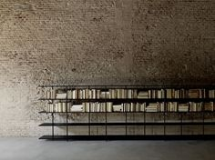 The Aero shelves are supported by a set of fluctuating vertical posts as if by magic, creating a new domestic totem. Bookcase consisting of shelves made. Light Architecture, Interior Architecture, Interior Design, Bookshelf Design, Bookshelves, Living Divani, Living Room, Loft Interiors, Headboards For Beds