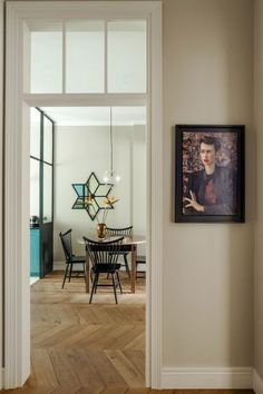 """House tour: a 1950s apartment gets a family-friendly makeover: The interior of the apartment is focussed around its woodwork: frames, doors with skylights and custom made furniture — all designed and produced by Colombe. """"I was trying to use only natural, original materials such as linens from polish manufactures and local solid oak on the floors. The final decoration are the paintings done by the young polish artists,"""" says Marta Chrapka of Polish design studio, Colombe Design."""