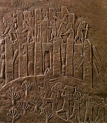 Ashurbanipal's brutal campaign against Susa in 647 BCE is recorded in this relief. Flames rise from the city as Assyrian soldiers topple it with pickaxes and crowbars and carry off the spoils.