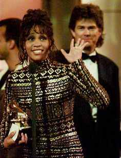 "Houston was honored at the 1994 Grammys, winning record of the year for ""I Will Always Love You"" and album of the year for the soundtrack from her movie ""The Bodyguard."""