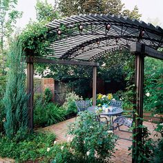 "Casual Curves  ""-- Short intervals between roof materials equal more shade for the space underneath the pergola.    -- A gentle roof curve provides a departure from the typical horizontal cover of most pergolas.    -- Vines can be trained up columns, but tall, narrow evergreens offer a way to integrate greenery with the vertical elements."""