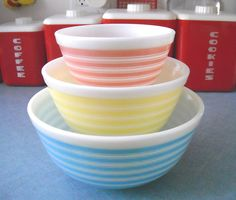 Pyrex stripes. I have that little pink bowl and a beige one about the size of the yellow. Would love to find the others.