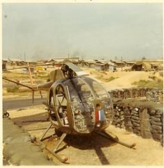 pictures of camp eagle vietnam | Note his M16 on his seat, and the crew chiefs M60 in the back with no ...