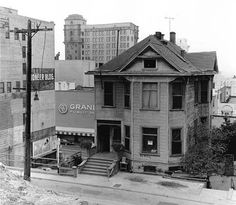 Duplex on Clay Street  Below left we see a duplex on Clay Street with the Million Dollar Building rising in the background. In the photo at right we see the steps alongside the 3rd Street tunnel portal, across 3rd Street from Angel's Flight.