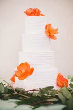 wedding cake with orange flowers - photo by Onelove Photography http://ruffledblog.com/romantic-wedding-handcrafted-by-the-groom #weddingcake #cakes