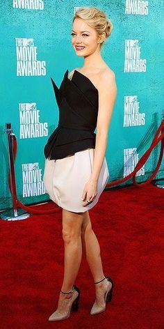 EMMA STONE  Always one to have fun with fashion, the Amazing Spider-Man star shines in an ivory-and-black frock, ankle-strap nude Brian Atwood heels, Tiffany & Co. jewelry and her new blonde hair at the MTV Movie Awards. #brianatwoodheelsfun #brianatwoodheelsanklestraps
