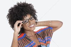 African american hair : Portrait of young woman in african print attire wearing glasses over gray background
