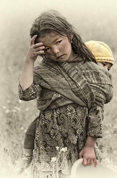 An all too common image I have seen all around the world.  Young girl taking care of even younger sibling...  #children #poverty #clicktopick https://www.clickittopickit.com/children-of-the-world