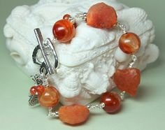 I like the mix of rough and polished stones in this piece.  Carnelian Bracelet Genuine Carnelian Gemstones by CaveGemstones, $38.00