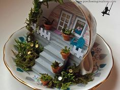 Recycled tea cup scene – Recycled Crafts I tend to buy random pretty tea cups and that means I have a bit of a collection. This idea for turning them into little tiny scenes is just darling. I bet you could make just about any topic you l… Tea Cup Art, Tea Cups, Cup And Saucer Crafts, Floating Tea Cup, Teacup Crafts, Mini Fairy Garden, Paper Crafts, Diy Crafts, Miniature Fairy Gardens