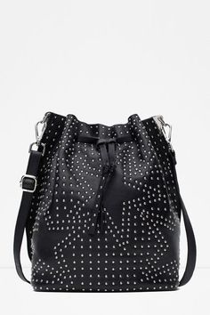 "35 Fall Essentials, Handpicked By Top Celeb Stylists #refinery29  http://www.refinery29.com/hollywood-stylist-fall-fashion-picks#slide-39  ""I have an obsession with stars that will never go away. When spending a lot of money on a bag, I tend to go with classic pieces. That's why this bag is great: it's more of a statement piece and not expensive at all."" ..."