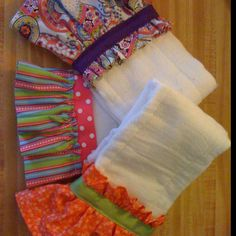 cute way to dress up those cloth diapers to cute burp cloths