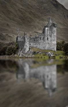 Kilchurn Castle ~ is a ruined 15th and 17th century structure on a rocky peninsula at the northeastern end of Loch Awe, in Argyll and Bute, Scotland. Access to the Castle is sometimes restricted by higher-than-usual levels of water in the Loch.