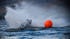 A jetski competitor rounds a buoy during a race and leaves a wake that is almost impossible for the next racer to see through.