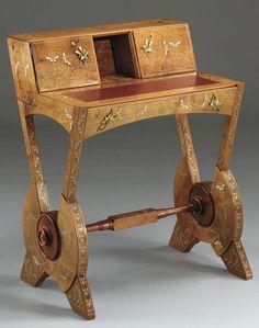 A FINE CARLO BUGATTI PEWTER AND BRASS-INLAID WALNUT DESK, CIRCA 1902 | UNSOLD Sotheby's New York, Dec. 6, 2002 [desk later sold for $108,000, Christie's New York, Dec. 19, 2006]
