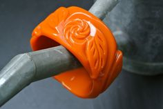 Massive Pumpkin Orange Fakelite Bangle ? Deeply Carved Effect ? 1940?s Style Flowers & Leaves