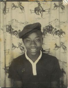 +~ Vintage Photo Booth Picture ~+  Young African American Youth in photo booth with retro cowboy curtain.