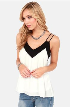This chiffon tank is perfect for date night! Sweet & sexy with bold black & white contrast!