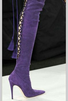 c154209ab0e Purple high heeled boots with tassels and cross hatching on the back.