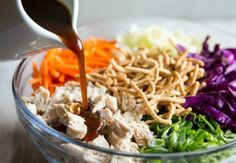 A square photo of Chinese Chicken Salad. The ingredients are sorted in sections and a small white pitcher is pouring salad dressing on one section. Chinese Chicken Salad Dressing, Asian Chicken Salads, Chinese Salad, Asian Dressing, Salad Bar, Soup And Salad, Asian Recipes, Healthy Recipes, Ethnic Recipes