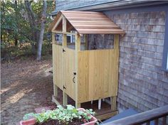 An outdoor shower with a roof. Shower outside, even in the rain!