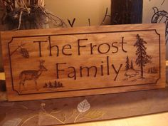 Rustic Family Last Name Welcome Signs Pine Tree Pine Cone Deer Primitive wood carved Sign Wooden Carved Cabin Plaque Doe Buck $40 at Etsy.com