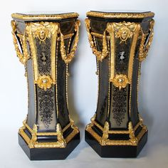 A Very Fine and Palatial Pair of French 19th Century Napoleon III Boulle Style Ebonized and Gilt-Bronze Mounted with Brown Tortoiseshell and Mother of Pearl Pedestal Stands, after a model by André Charles Boulle (1642-1732), each centered with an ormolu allegorical mask surmounted with floral wreaths and acanthus, the borders with chased ormolu trims, each with a finely chased figure of a dancing maiden playing the tambourine, one edged in mother of pearl the other in brass inlaid, with an…