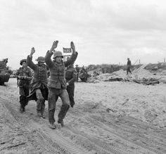 German POWs being escorted along one of the Gold area beaches. (June 6, 1944). Source: Imperial War Museums, B 5257.