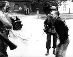 Dachau, Germany, A fight between an inmate and a German soldier who was caught by American soldiers.