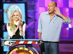 Singer Avril Lavigne and Actor Bruce Willis present the Favorite Movie Actress Award onstage at the 19th Annual Kid's Choice Awards held at ...