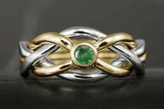Narrow style puzzle ring in white and yellow gold, featuring a natural faceted emerald. Handmade to your size by Vansee…