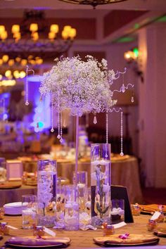 When it comes to the wedding reception décor, all eyes will be on the dinner tables. From low and delicate to high and cascading, get inspired by these magnificent wedding centerpieces. Click the image to enlarge and see the photo credit.