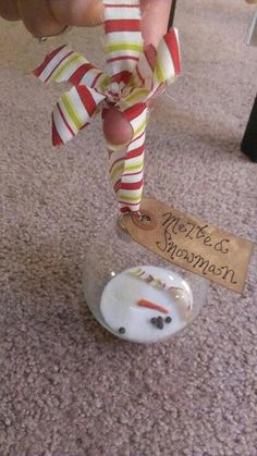 Christmas Party Ideas: Melted snowman ornament craft. Salt, cloves, and orange paper. Clever!