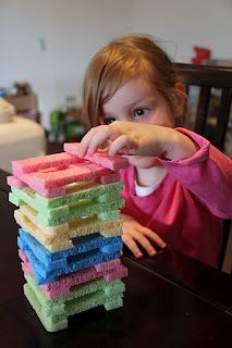 sponge jenga write facts on them for math workstation (as each partner answers a fact correctly, they get to add their jenga piece)