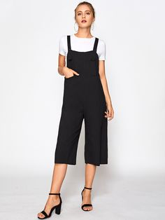 Sleeveless Denim Overalls. Denim Overalls Decorated with Button, Pocket. Designed with Straps. Loose fit. Mid Waist. Perfect choice for Casual, School wear. Plain design. Trend of Spring-2018, Summer-2018. Designed in Black. Fabric has no stretch.