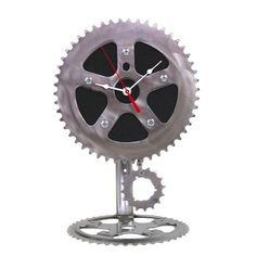 Desk Pendulum Clock. Remember the childhood nostalgia of riding a bike with this funky and arresting clock made from a bicycle cog, wheel and chain section. The face is also made from black recycled tire rubber to really capture the theme. $88.00