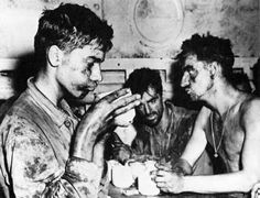 In one of the classic photographs of the Pacific War, dog-tired and battle-grime-coated Marines, thankful to be off the island and still alive, relax with a hot cup of coffee on board ship after victoriously ending the bruising fight for Eniwetok atoll in the Marshalls, February 1944.