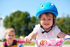 Teaching your child to ride a bike on two wheels.     Learning to ride a bike is one of childhood's treasured milestones.