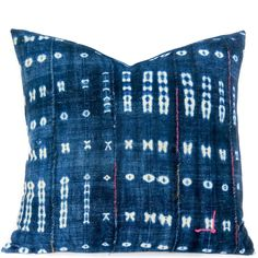 "This textile is called ""Thioup"" which is a bazin riche cotton from Mali. Narrow handwoven strips are stitched together to make single a cloth, then dip dyed several times in indigofera [indigo] to Throw Pillows Bed, Down Pillows, Turquoise Kitchen, Blue Couches, White Decor, Home Accessories, Indigo, Hand Weaving, Blue And White"