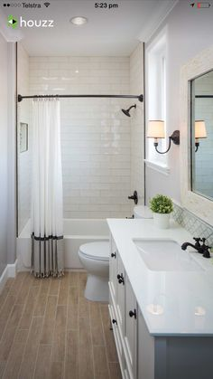 Love the oil rubbed bronze - possibly option for new house with white subway tiles