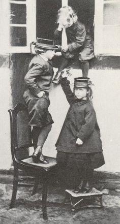 Prince Wilhelm (future Kaiser Wilhelm II of Germany), Princess Charlotte and Prince Heinrich of Prussia